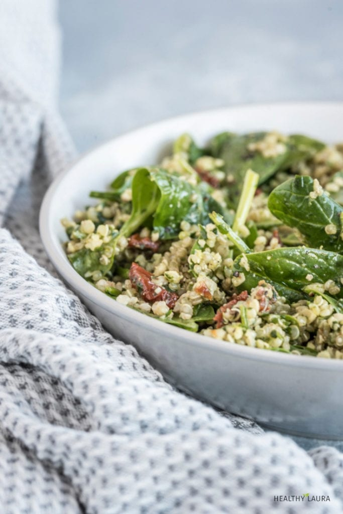 Quinoa Salad with Pesto & Sundried Tomato by Healthy Laura Food Photography & Styling. @healthylauracom HealthyLaura quick and easy quinoa salad recipe with pesto. It's an easy dairy free recipe and a quick healthy easy paleo lunch or side dish that is gluten-free, grain free. #intuitiveeating #breakfastrecipe #easyrecipes #intuitiveeatingtips #healthylifestyle #healthyeating #nodietdiet